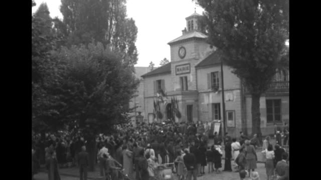 """title """"french town fetes 'ike' in 'family party'"""" superimposed over gen. dwight eisenhower, supreme commander of nato, walking along with mayor jean... - parchment stock videos & royalty-free footage"""