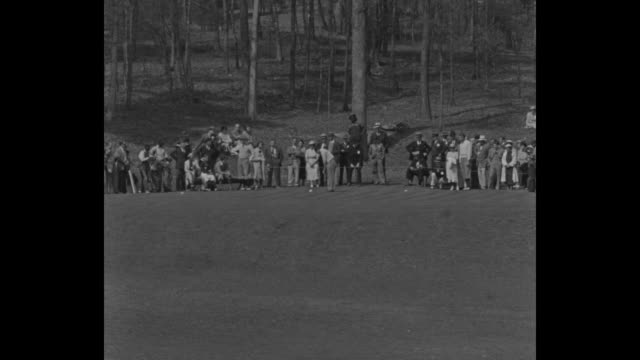 Golf superimposed over golfer teeing off spectators behind him / Bobby Jones crosses bridge over small stream with caddy / he hits ball from bunker...