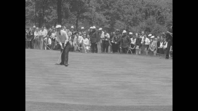 """golf"" superimposed over pga championship and denny shute driving / shute with gallery behind him / harold mcspaden driving with gallery behind him /... - drive ball sports stock videos & royalty-free footage"