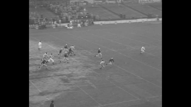 'Gridiron Parade' superimposed over touchdown play / kickoff and 57 yard return by Texas Davey O'Brien / Polo Grounds stadium audience / O'Brien...