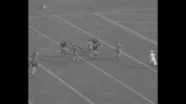 Title 'Gridiron Review' superimposed over football game play / VS game plays / near end zone Hercules Renda passed to Elmer J Gedeon who scores...