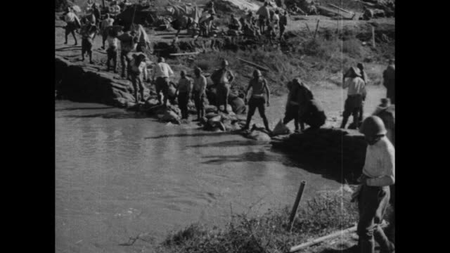 title in japanese writing superimposed over japanese soldiers marching through countryside during battle of shanghai in second sinojapanese war /... - japanese military stock videos & royalty-free footage