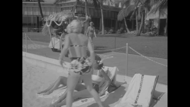 vídeos de stock, filmes e b-roll de it's a 'shaxi' not a taxi in hawaii superimposed over golf cart in front of hotel / women in bathing suits on beach / shaxi pulls up in front of... - golf cart