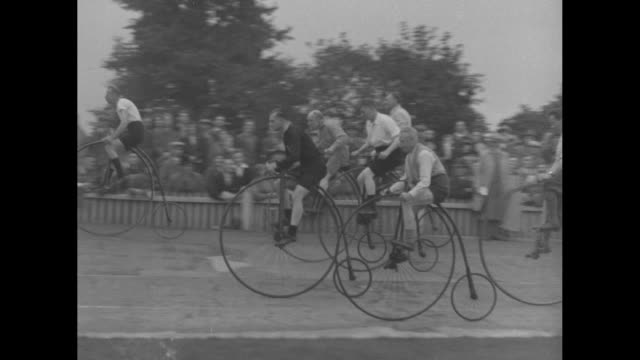 "stockvideo's en b-roll-footage met ""jolly old whoopee! london - a rattling good time for grandpop! ancient 2-wheelers show there's pep in the old spokes yet"" / bicyclists aboard... - 1930"