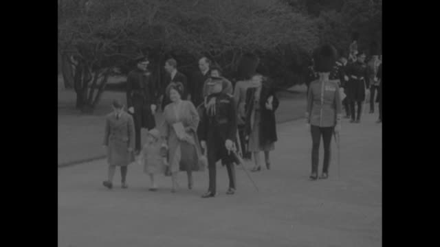 king george honors his guardsmen superimposed over officers of the coldstream guards conducting troop review / guards standing at attention on the... - prinz michael von kent stock-videos und b-roll-filmmaterial