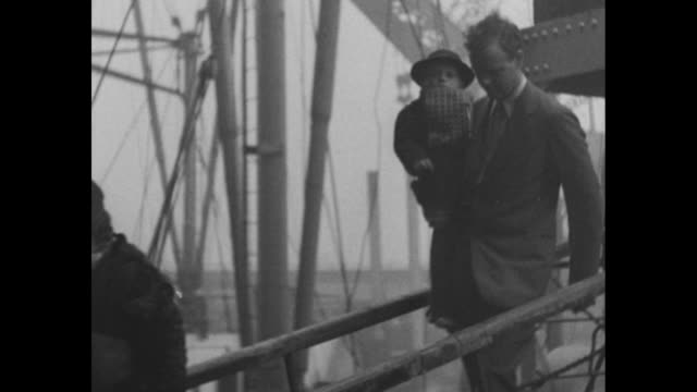 lindbergh superimposed on ship sailing into port in england / aviator charles lindbergh and wife anne come down gangway from ship lindbergh holding... - charles lindbergh stock videos & royalty-free footage