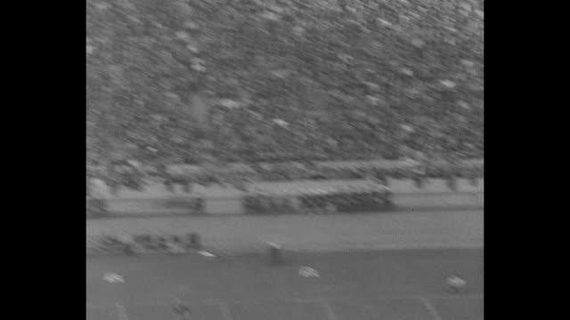 los angeles calif superimposed over halftime show and fans in stands at los angeles memorial coliseum during college football game between university... - university of california stock videos and b-roll footage