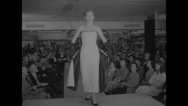 """main street fashions"" superimposed over two models displaying fish net coats over lounge pajamas they are wearing during fashion show of seagraves... - tights stock videos & royalty-free footage"