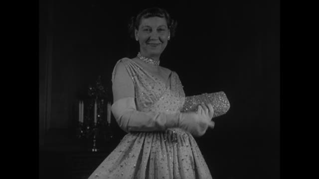 title mamie's inaugural gown superimposed on incoming us first lady mamie eisenhower wearing gown / she models gown sparkly purse long gloves / tilt... - first lady stock-videos und b-roll-filmmaterial