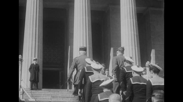 melbourne superimposed over wide shot of shrine of remembrance war memorial / free french sailors and two officers walking towards shrine / free... - anzac day stock videos & royalty-free footage