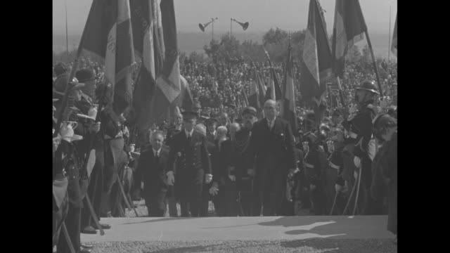 title montfaucon france superimposed on dignitaries climbing stairs flanked by series of flags as they arrive for dedication of montfaucon american... - john pershing stock videos & royalty-free footage
