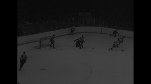 """title """"montreal wins the stanley cup!"""" superimposed over ongoing game / crowd in stands / game play / canadien jean beliveau scores, silhouettes of... - toe stock videos & royalty-free footage"""