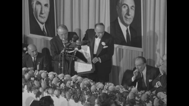motion picture pioneers honor warner bros superimposed on view of jack harry albert warner holding plaque / guests sit at tables in starlight roof... - warner bros stock videos & royalty-free footage