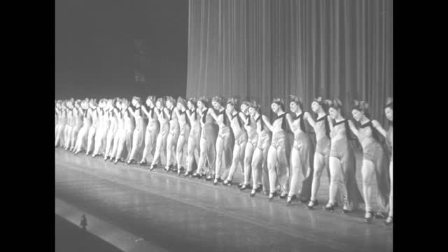 """""""music hall rockettes paris bound"""" superimposed over chorus line dancing / vs rockettes practicing routine on stage / dancing feet of rockettes /... - radio city music hall stock videos & royalty-free footage"""