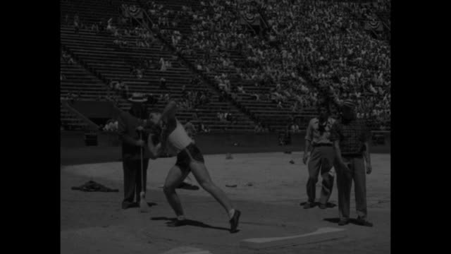 """""""national collegiate track meet!"""" superimposed over race / vs runner run on track past camera / art bragg / darrow hooper of texas a&m throws shot... - shot put stock videos & royalty-free footage"""