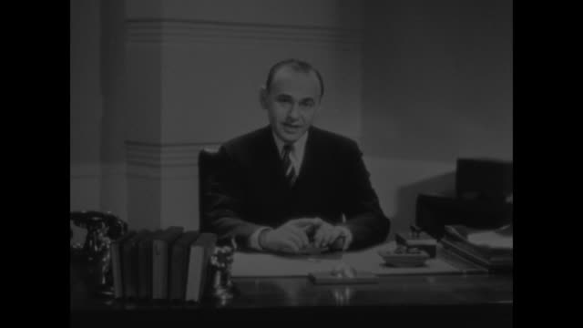 "stockvideo's en b-roll-footage met ""new york city"" superimposed over cbs television executive gilbert seldes, seated at desk in office/ vs he speaks to camera / note: exact day not... - 1930"