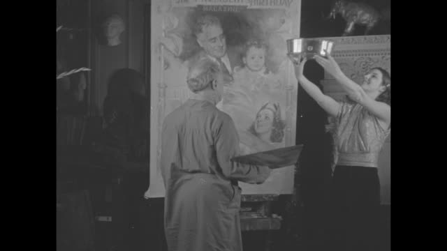 title new york superimposed on christy in front of painting with smiling model holding cake pan in air christy looks at camera painter with model his... - polio stock videos and b-roll footage