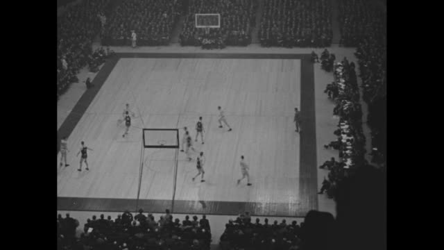 new york superimposed over basketball court / high angle of game / players jump for ball / nyu runs ball intercepted by notre dame and scores / high... - new york university stock videos & royalty-free footage