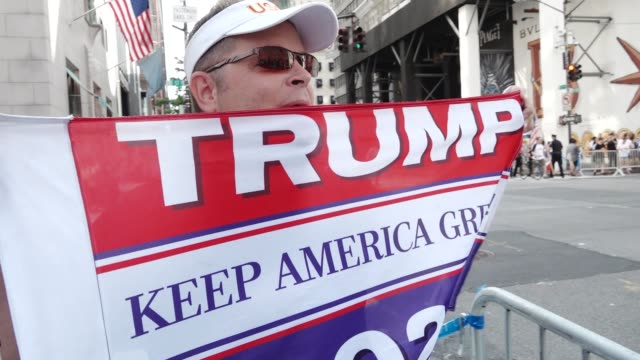 Title of protest 'Trump Pence Must GO' Activist from RefuseFascismorg and Black Lives Matter of Greater New York gathered on 5th Avenue and East 57th...
