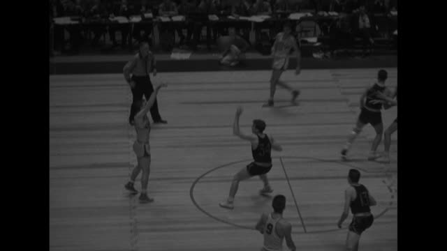 Olympic Basketball Final superimposed over action shot of game in Madison Square Garden / various action shots of game between AAU's Peoria...