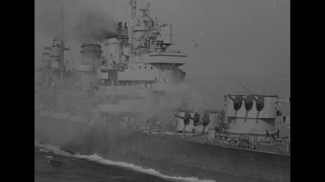 1st pictures bomb hit on us cruiser off italy/ vs ship steaming along and smoke pouring from ship / pan across ship as it steams past camera /... - fire hose stock videos and b-roll footage