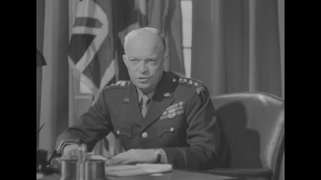 general eisenhower / cu gen dwight eisenhower supreme commanderinchief of allied invasion forces sitting at desk at his london headquarters speaking... - formato hd video stock e b–roll