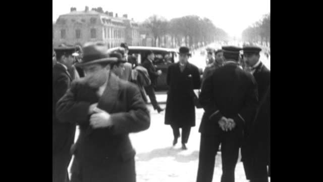 title page in french / crowd in front of palace of versailles / cars parked in front of palace / policeman checking identification of member of... - former stock videos and b-roll footage