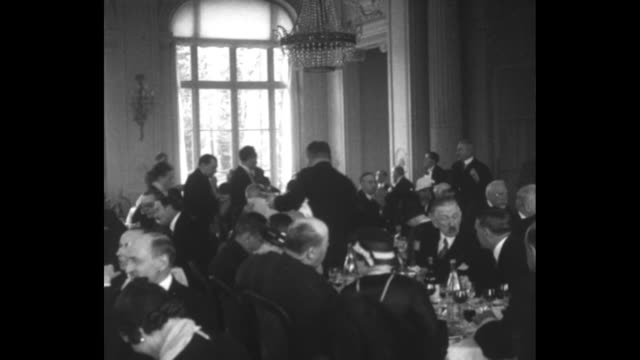 stockvideo's en b-roll-footage met title page in french / shot of exterior of hotel, people coming and going through its entrance / vs people sitting at tables in dining room of hotel... - dining room