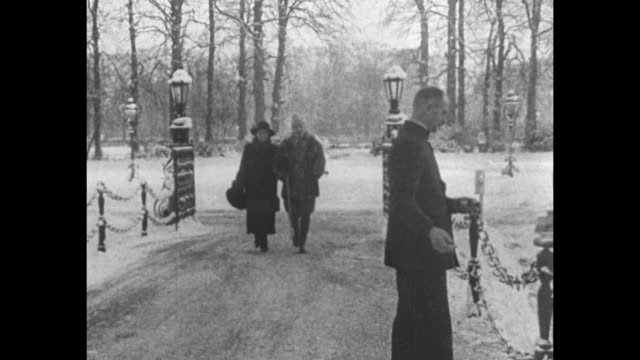 title page in german and dutch, words reversed as in mirror / wilhelm and hermine walking down sidewalk leading from their house and then along road,... - esilio video stock e b–roll