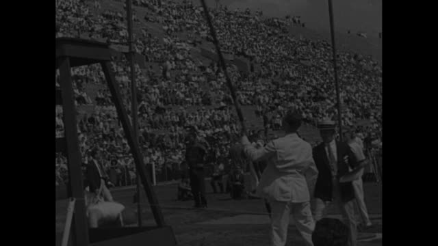 Marks Set In PreOlympic Track Tests / Title Princeton NJ superimposed over crowd in stands / two shots of 100meter dash Jesse Owens winning / George...
