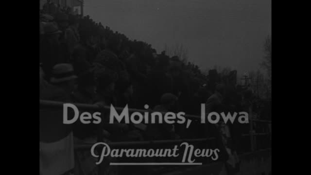'Olympic Stars Dominate 1937 Track Meets' / title 'Des Moines Iowa' superimposed over crowd in stands at Drake Stadium during the Drake Relays track...
