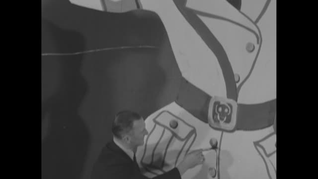 portraits axis leaders flayed by their countrymen / three artists from art students league painting large caricatures of hirohito hitler and... - lynching stock videos & royalty-free footage