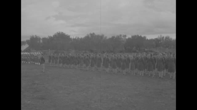 wacs gen clark honors fifth army women / wacs stand in formation on field / general mark clark walks along front of formation with two other officers... - womens army corps stock videos & royalty-free footage