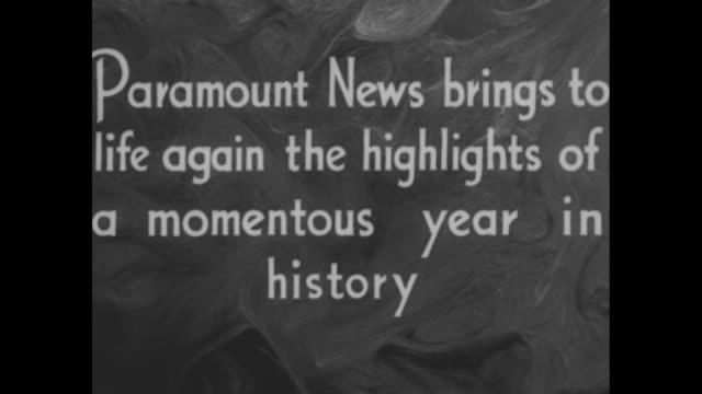 paramount news presents 1936 passes in review paramount news brings to life again the highlights of momentous year in history / title progress in... - 1936 bildbanksvideor och videomaterial från bakom kulisserna