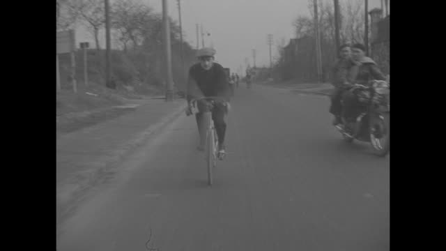 title paris superimposed on man with bicycle with propeller / vs man pedals as propeller spins man riding bike / vs man seated in threewheeled... - handlebar stock videos & royalty-free footage