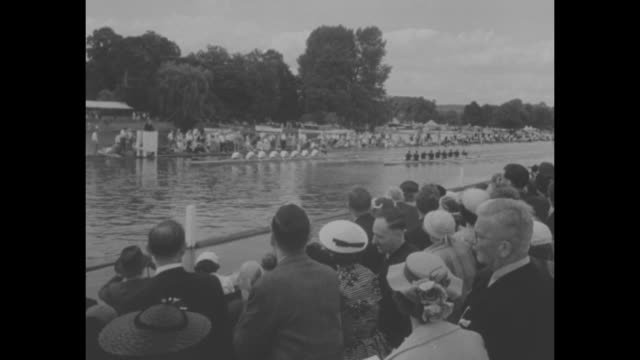 Penn Outrows Canadians at Henley Regatta superimposed over general view of the banks of the Thames River / montage QS crowd three women in small boat...