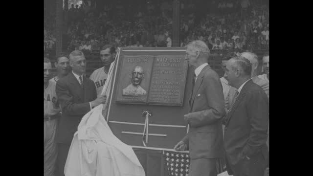 philadelphia superimposed over philadelphia athletics team standing on field at shibe park during plaque presentation ceremony for manager connie... - plakette stock-videos und b-roll-filmmaterial