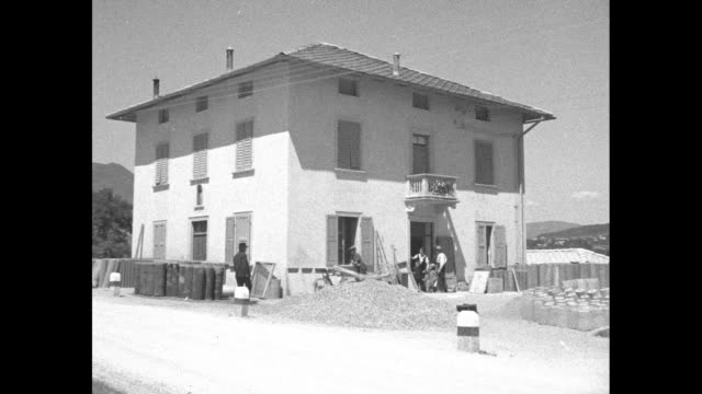 quadruplets thrill italy superimposed on exterior of twostory house in countryside / inside house mary cardelicchio sits in chair holding four... - taranto province stock videos & royalty-free footage