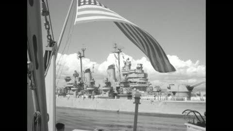 "title ""remember pearl harbor"" superimposed over file footage of japanese bomb striking us navy battleship uss arizona / aerial shot of sunken hull of... - warship stock videos & royalty-free footage"