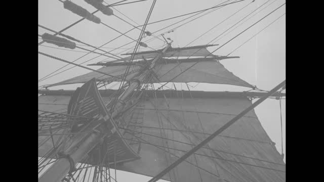 """title """"rhode island"""" superimposed over old-fashioned sailing ship """"seven seas"""" next to dock in newport / shot from above of sailors climbing onto... - harbour stock videos & royalty-free footage"""