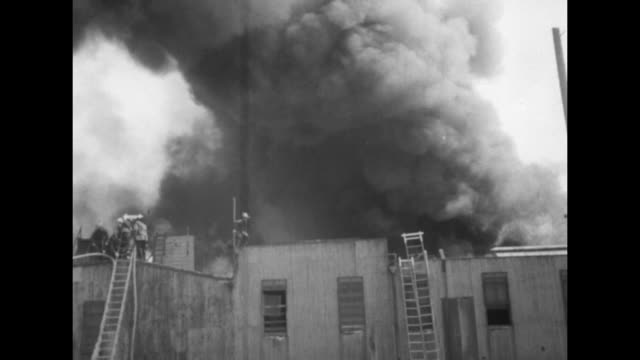 stockvideo's en b-roll-footage met title san francisco blaze takes $500000 toll superimposed over building on fire smoke / flames shooting from top of building billowing smoke /... - fire hose