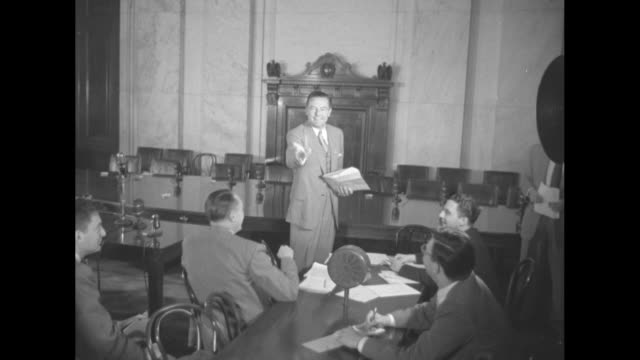 """""""senator lodge opens gop drive for ike"""" superimposed on room filled with journalists sitting at tables / lodge speaks to journalists / journalists... - キャンペーンバッジ点の映像素材/bロール"""