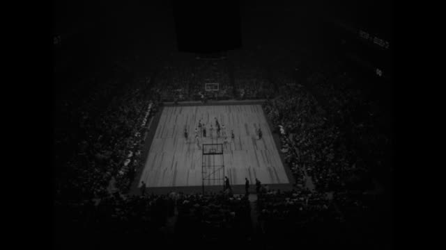 seton hall tops st john's for nit title superimposed over jump ball to begin game in madison square garden / several action shots of game between... - jump shot stock videos and b-roll footage