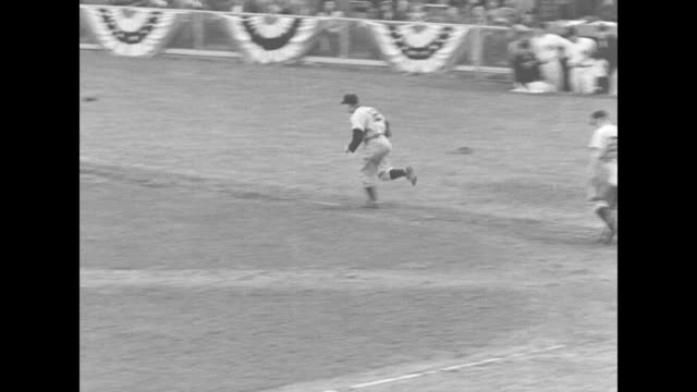 "title ""sixth game"" superimposed over fans in box seats at yankee stadium for game 6 of the world series / yankees' #35 yogi berra gets a hit, runs to... - baseball pitcher stock videos & royalty-free footage"