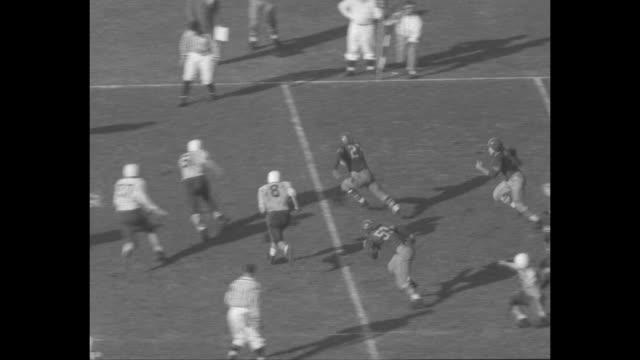 so california vs stanford superimposed over football game play / stanford indians quarterback bob garrett passes to john steinberg who runs through... - pom pom stock videos & royalty-free footage