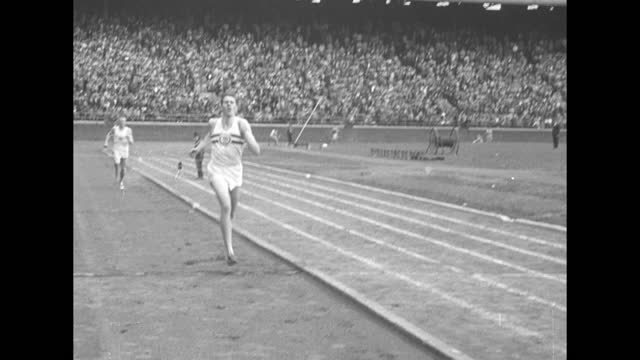 """title """"sports"""" superimposed over illustration of athletes / title """"4-minute mile cracked-bannister does it"""" superimposed over runners on track /... - illustration stock videos & royalty-free footage"""