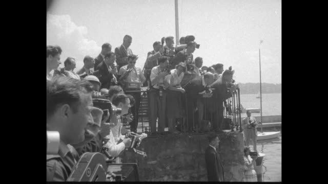 Title superimposed First Lady is hostess on a boat ride / Mamie Eisenhower Clarissa Eden Lucie Faure aboard boat / swarm of cameramen / the ladies...