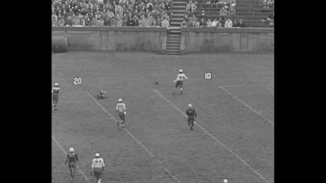 Title superimposed ñNew Haven Connî over huge crowd of people / Yale passes player slips in mud / Yale passes man falls in end zone / crowd / Yale 68...