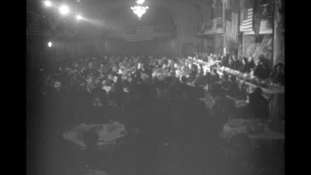 title superimposed on banquet us leaders plan 1951 brotherhood week / spyros skouras presents award to nelson rockefeller / high angle views of... - ネルソン a ロッカフェラー点の映像素材/bロール