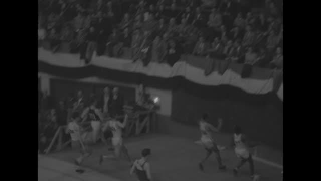 title superimposed on boston garden gehrmann wins mile in k of c meet / harrison dillard wins 45 yard hurdles runs to padded stop / arthur bragg wins... - men's track stock videos and b-roll footage